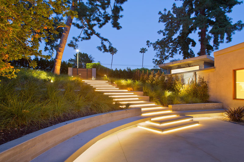 Hidden lighting instantly transforms these stairs into a dramatic entrance at night.