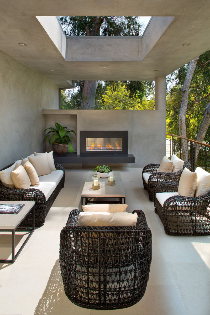 This partially covered outdoor lounge has a fireplace to enjoy when it gets cool.