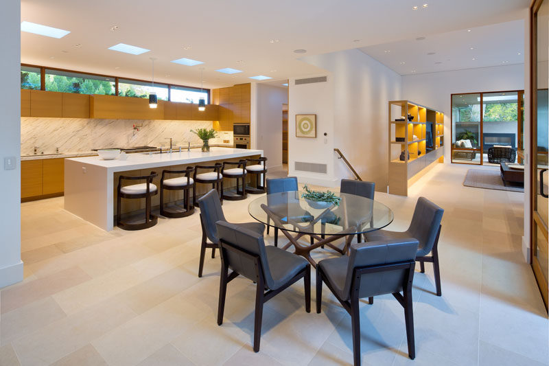 This kitchen has a small dining area and a large island...big enough to seat five people.