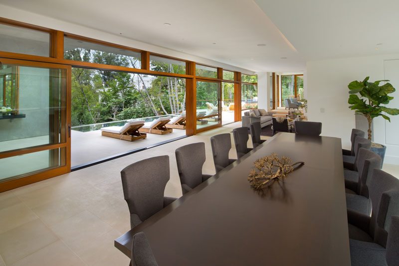 This dining room has a table large enough to seat twelve people, and it opens out onto the deck.