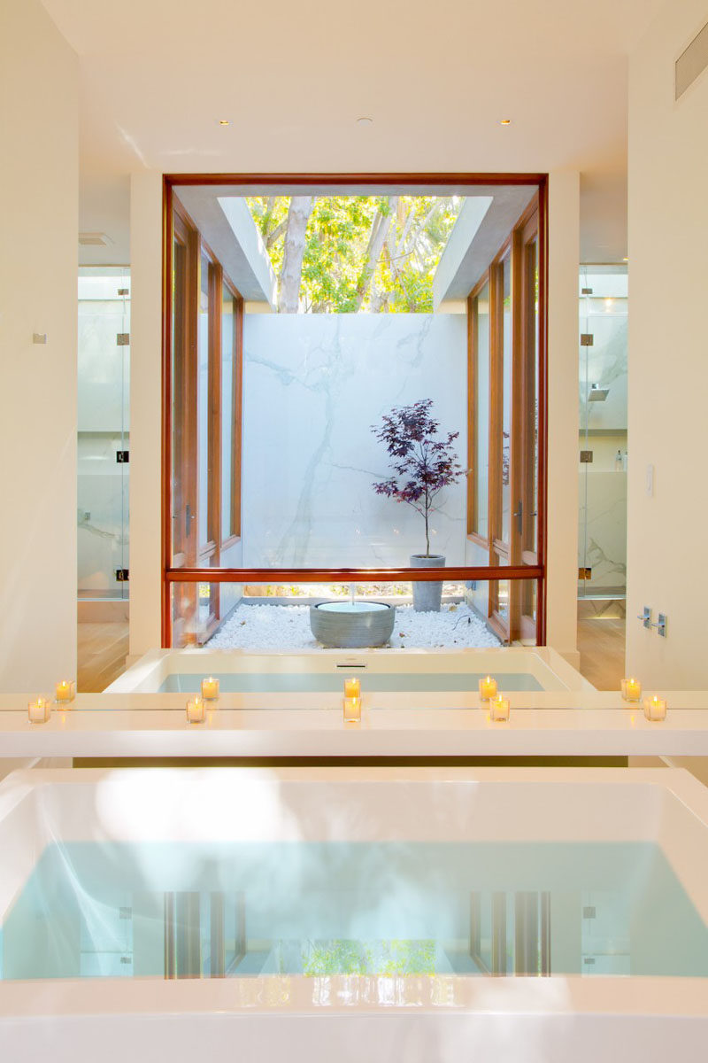 This master bathroom has its own little outdoor space, adding lots of natural light.