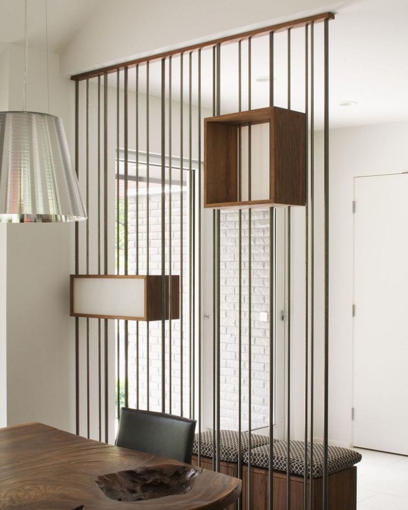 15 Creative Ideas For Room Dividers // This space divider, made of metal rods and suspended boxes, separate the entrance way from the dining area without making either one feel closed off.