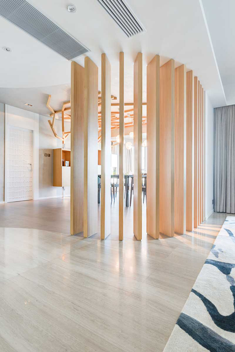 15 Creative Ideas For Room Dividers // This contemporary apartment has lot of elements of nature throughout it, including the wooden space divider between the dining and living areas.  #ModernRoomDivider #RoomDivider #InteriorDesign #Interiors