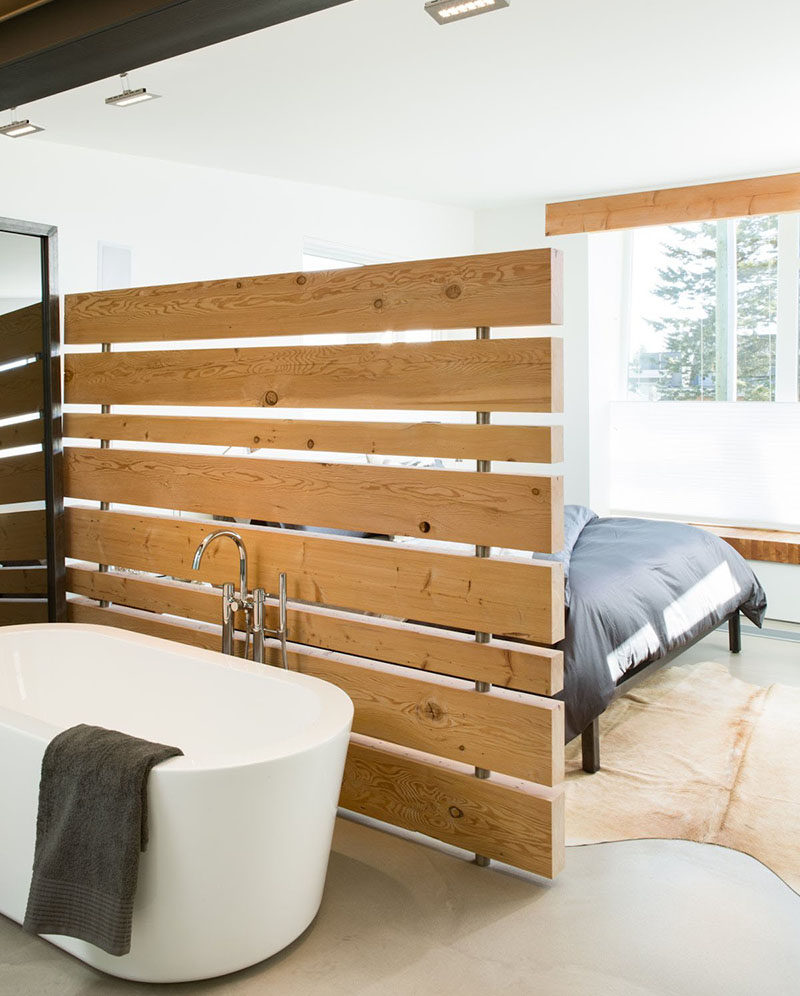 15 Creative Ideas For Room Dividers // A wood panel wall separates the tub from the bed in one of Canada's greenest homes.  #ModernRoomDivider #RoomDivider #InteriorDesign #Interiors