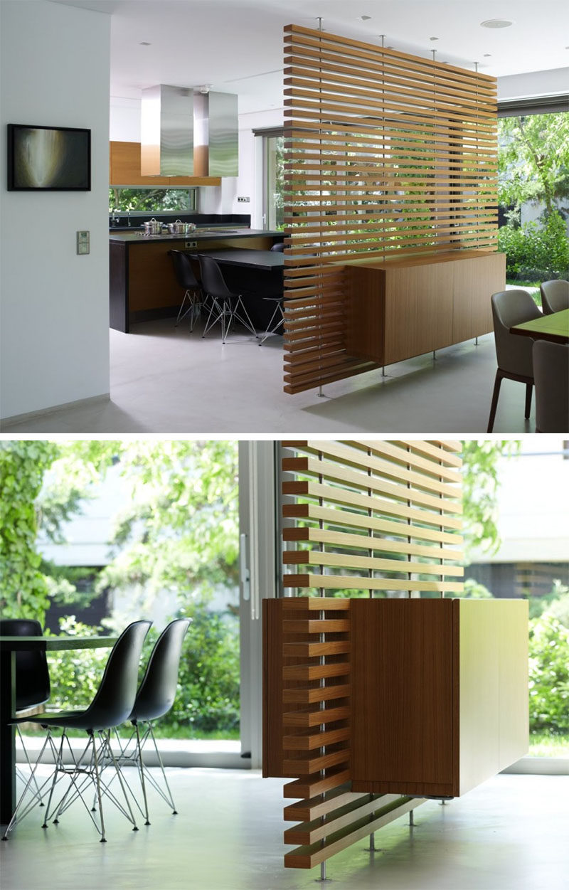 15 Creative Ideas For Room Dividers // This slatted wooden room divider has a built-in cabinet. #ModernRoomDivider #RoomDivider #InteriorDesign #Interiors