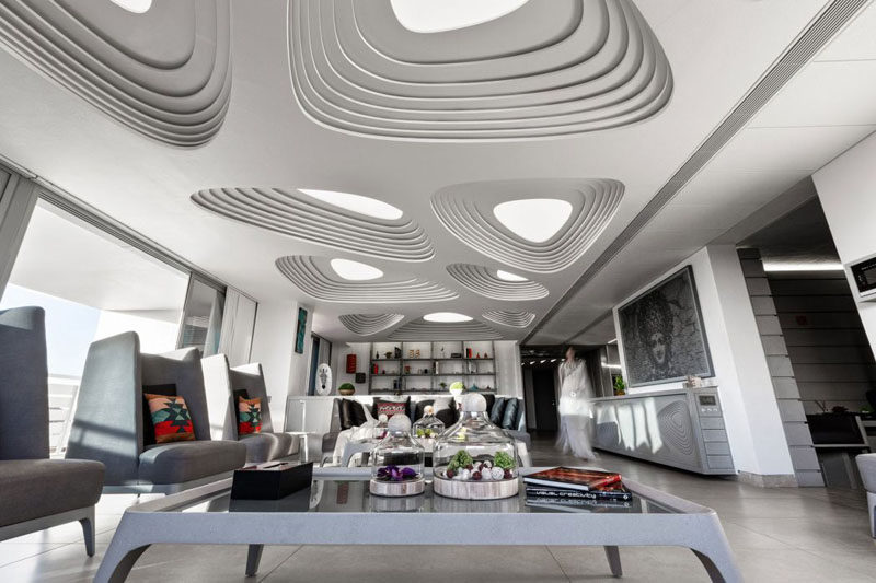 13 Amazing Examples Of Creative Sculptural Ceilings // The futuristic feel of this penthouse is accentuated by the design of the ceiling.