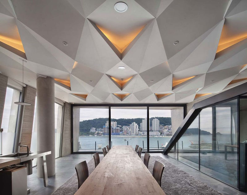 13 Amazing Examples Of Creative Sculptural Ceilings // The sculptural geometric design of this ceiling makes the room almost space-like.