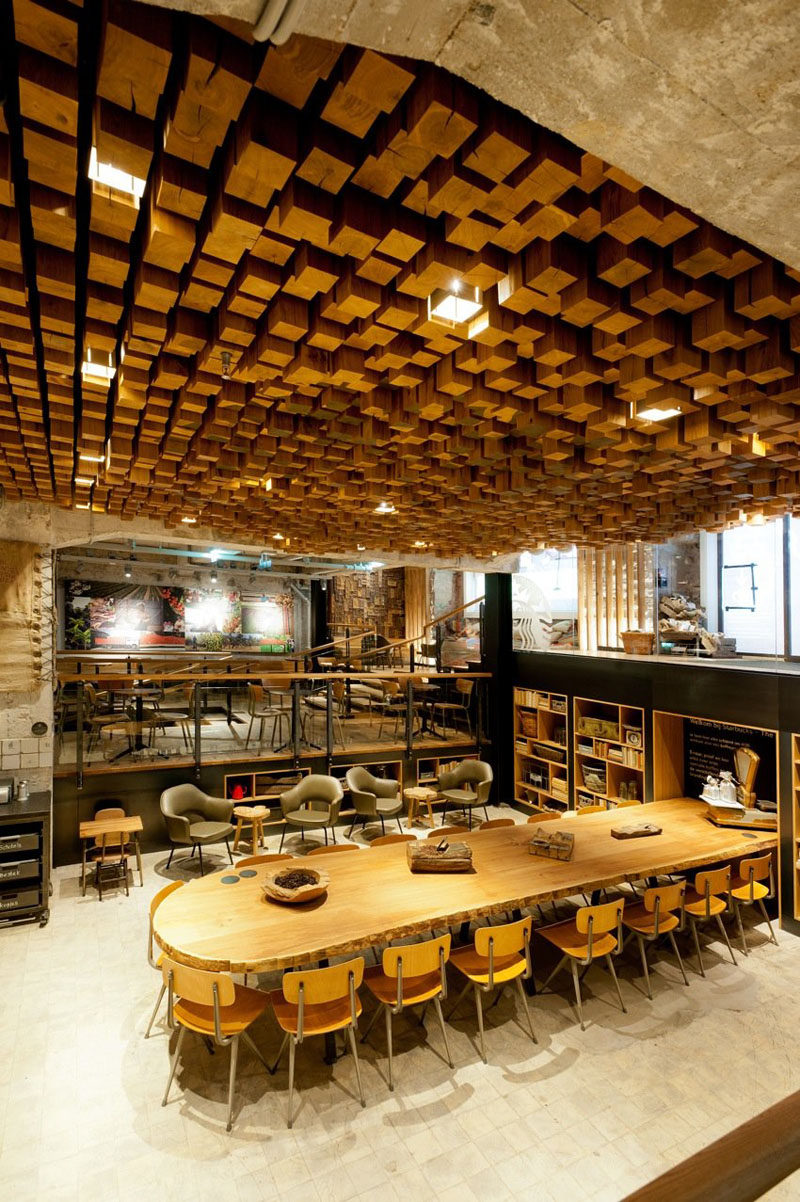 13 Amazing Examples Of Creative Sculptural Ceilings // This Starbucks ceiling in Amsterdam is made of 1,876 pieces of individually cut blocks of Dutch oak.