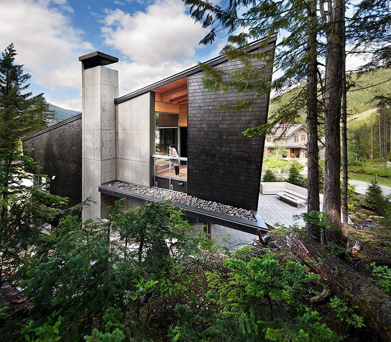 13 Examples Of Modern Houses With Wooden Shingles // Black shingles on the side of this Whistler property, contrast the natural wood and concrete throughout the rest of the house.