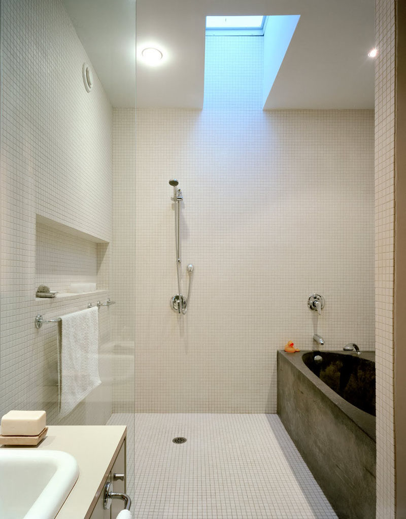 12 Ideas For Including Built-In Shelving In Your Shower // The shower and bath are kept in an area separate from the rest of the bathroom which features a built in shelf perfect for storing the essentials.