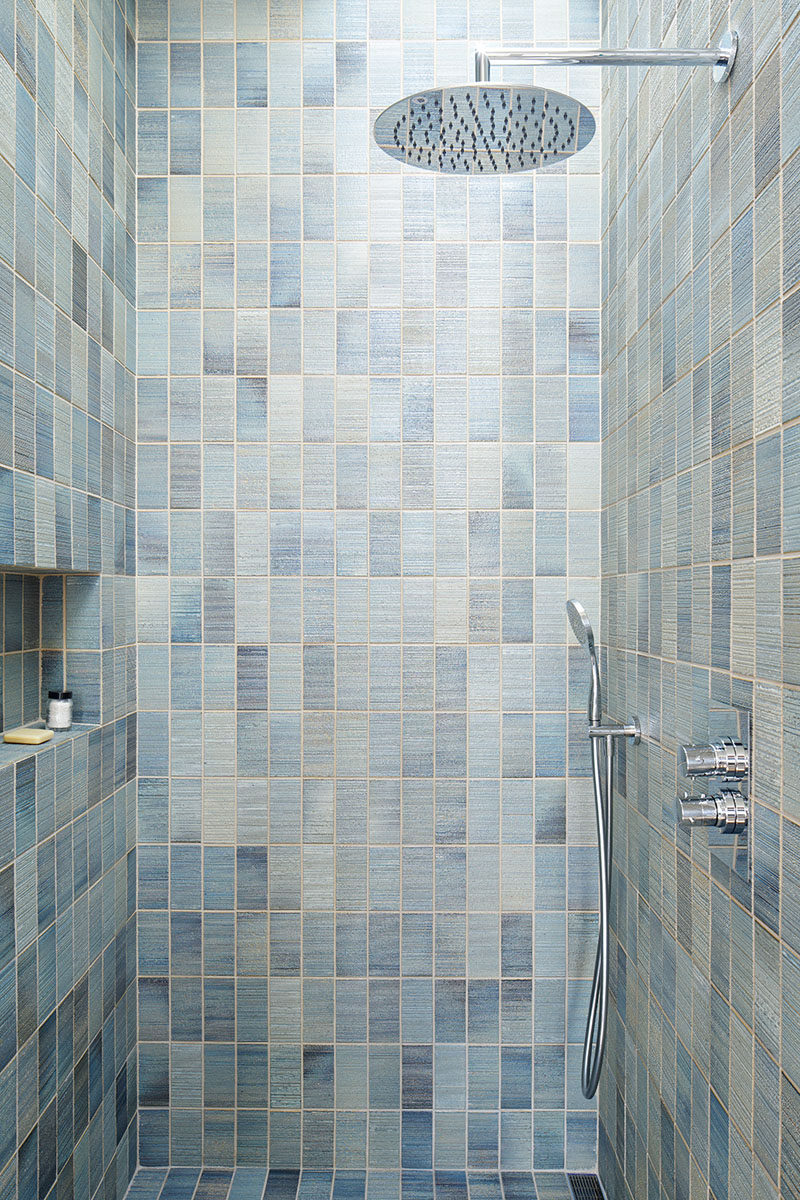 12 Ideas For Including Built-In Shelving In Your Shower // The built-in shelf in this shower makes the most of the small space.