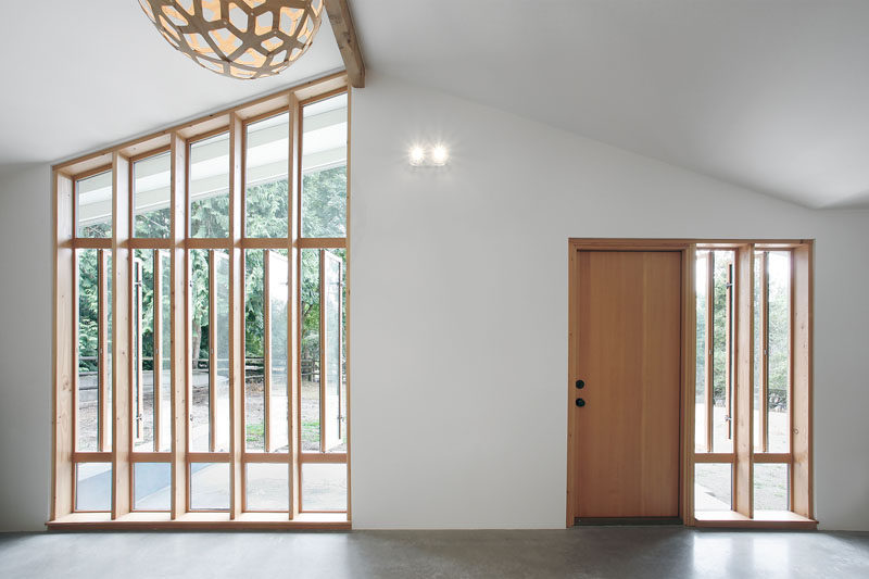 White walls, a pitched ceiling, touches of wood and concrete floors, make up the interior color palette in this guest house.