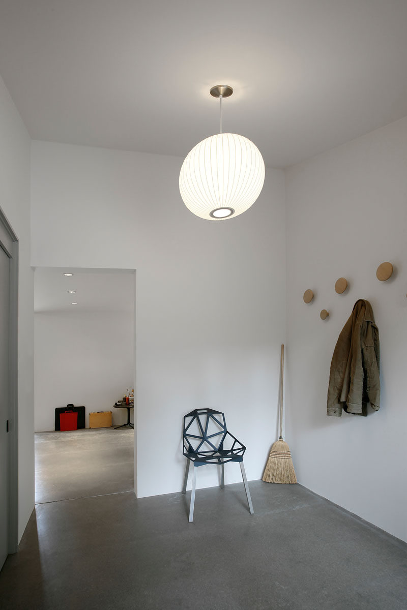 This former stable converted into an artists studio, has a minimalist mudroom.