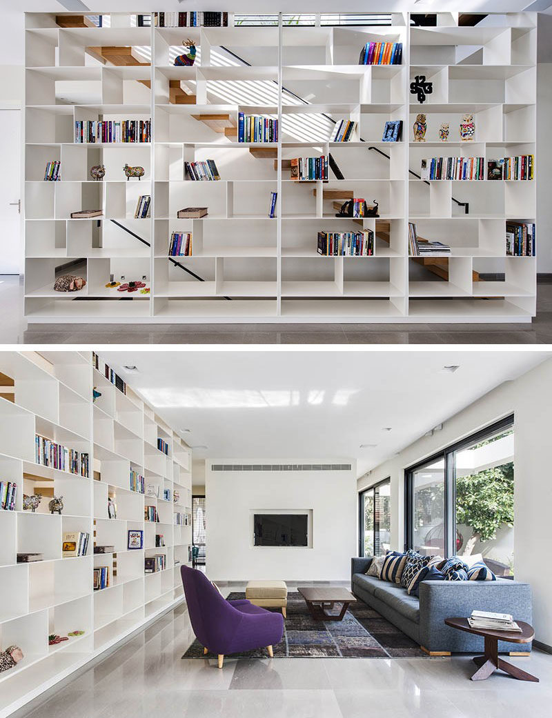 9 Stylish Staircases With Bookshelves As Safety Rails // The open shelving alongside this staircase lets light through and makes the stairs feel much more open.