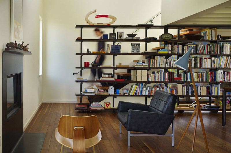 9 Stylish Staircases With Bookshelves As Safety Rails // This small house maximizes storage with a bookshelf on one side of the stairs.