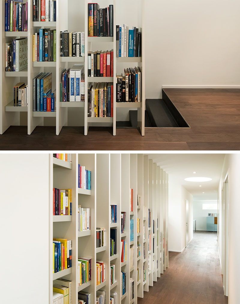 9 Stylish Staircases With Bookshelves As Safety Rails // This bookshelf acts as a safety barrier between the stairs and the corridor.