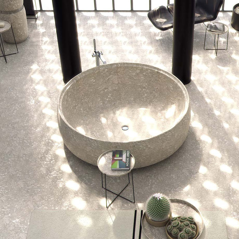 8 Stunning Examples Of Stone Bathtubs // The GRAL tub by SIGN, is carved from a single excavated solid piece of stone.