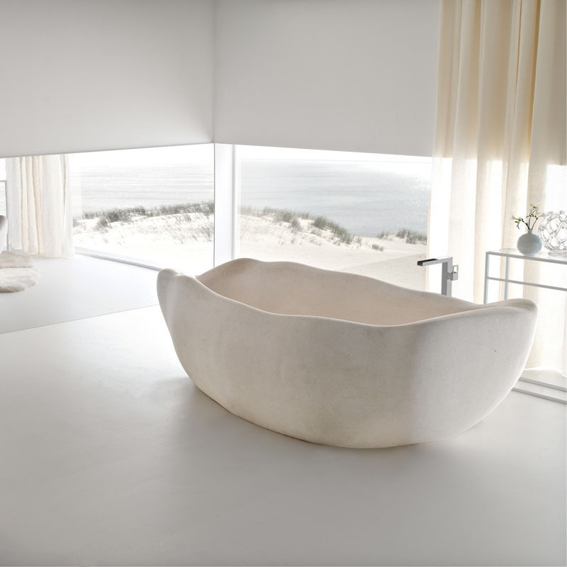 8 Stunning Examples Of Stone Bathtubs // Le Acque tub is a limited edition bathtub designed by Claudio Silvestrin for Toscoquattro, and is made from Supai stone.