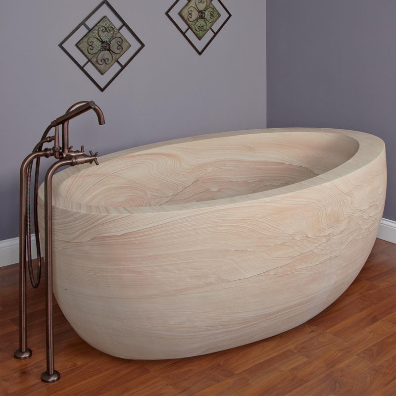 8 Stunning Examples Of Stone Bathtubs // This bathtub is handcrafted from a solid block of natural sandstone making every one unique.