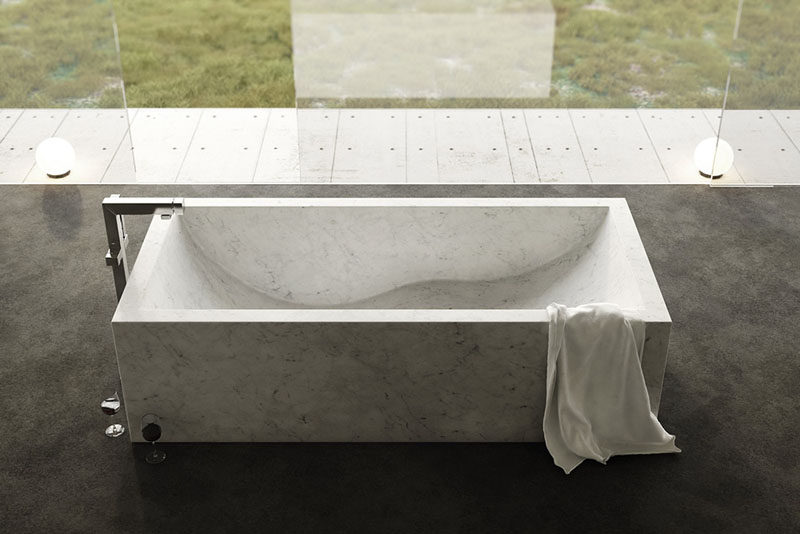 8 Stunning Examples Of Stone Bathtubs // The Onda Bathtub from The Vero Stone, is hand chiseled from Italian natural stone.