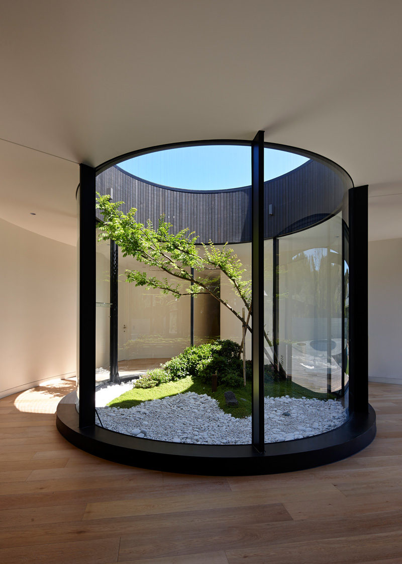 This Atrium Adds Nature And Light Inside This Home