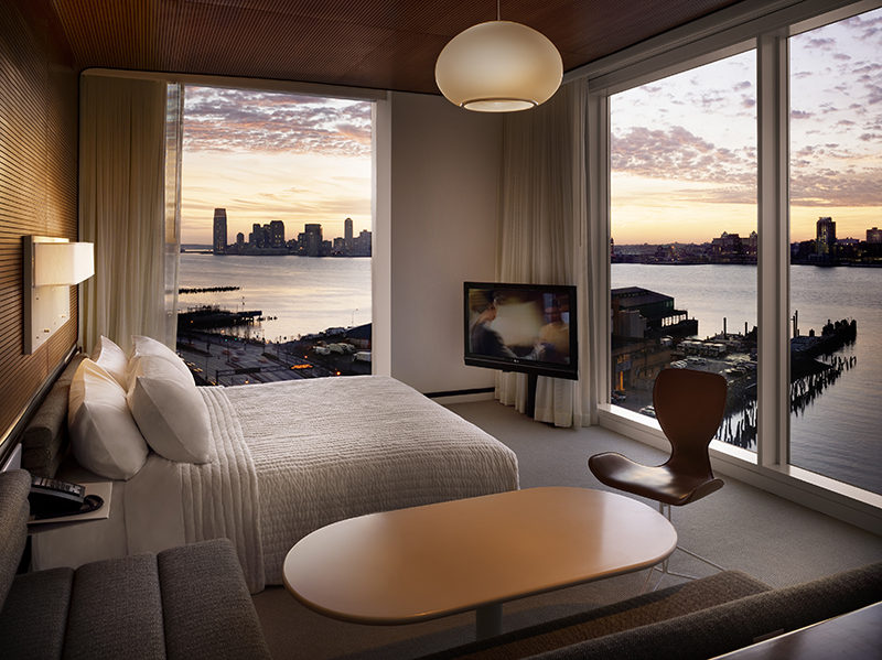 Televisions mounted on a post or pole are a minimalist, unobtrusive way to elevate your TV, without the bulk of a huge entertainment console or the need for creating holes in the walls.