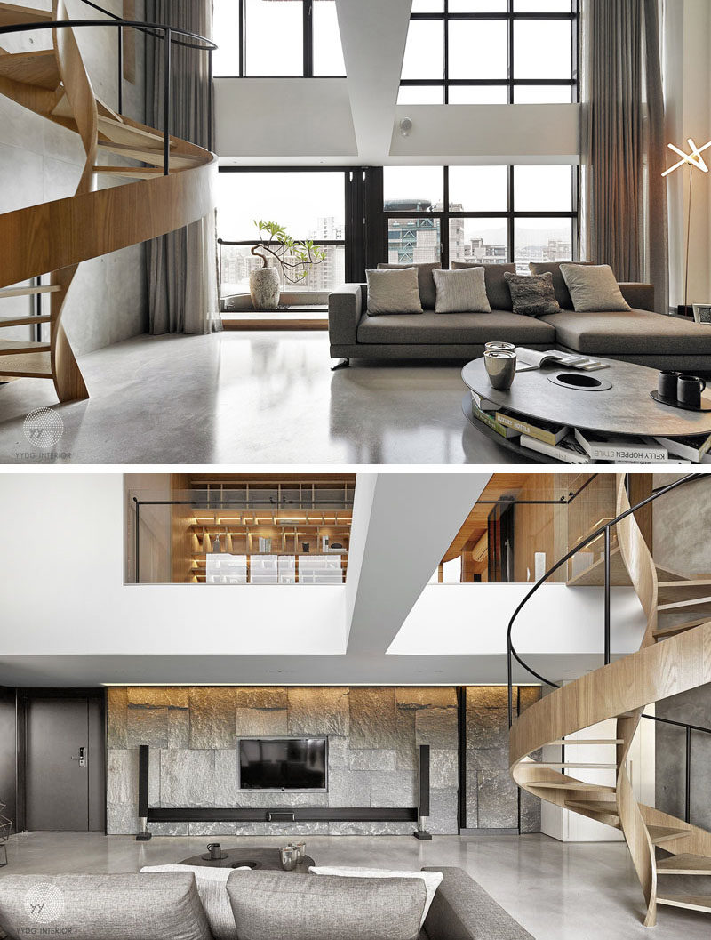 Located off to the side of this living room, is a twisted staircase that almost doubles as a sculptural art piece.