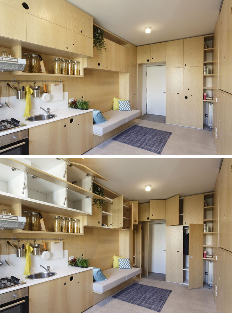 This tiny apartment has the lounge and kitchen sharing the space, with lots of cabinetry for storage.