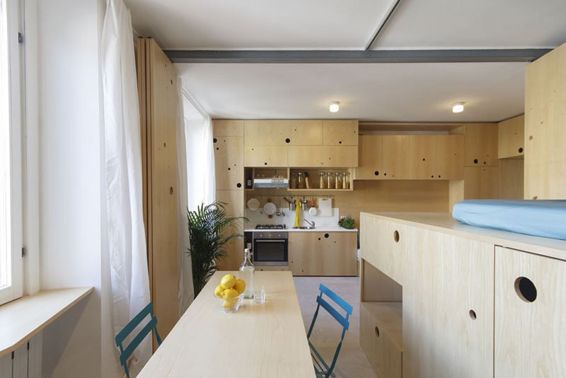This tiny apartment has a lounge, kitchen, dining room, lofted bed and a bathroom.