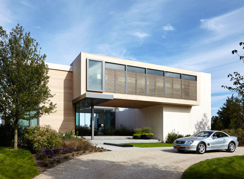 This home, located in North Haven, New York, has a central void that provides water views from the driveway, right through the house and into the backyard.