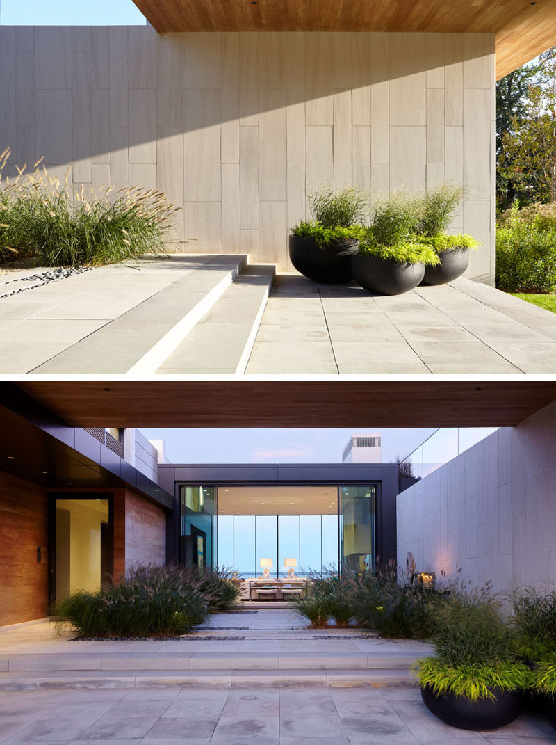 Upon entering this home, there's a central courtyard before you reach the front door and main living area.
