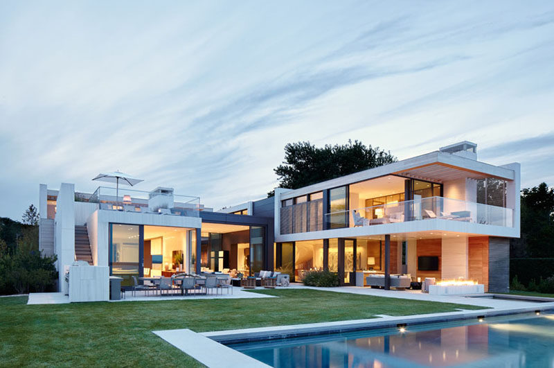 This house opens up into a landscaped yard, that has various outdoor spaces and a swimming pool.