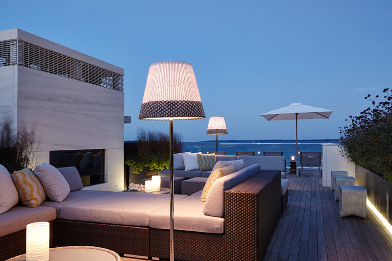 This roof deck has multiple lounges, sun chairs, stool and also a fireplace.