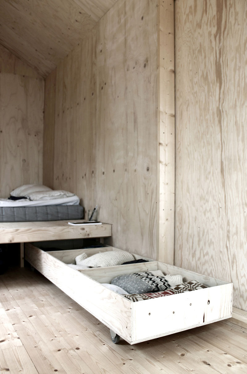 -Bed Storage // The bed in this tiny cabin by SEPTEMBRE, has pull out ...