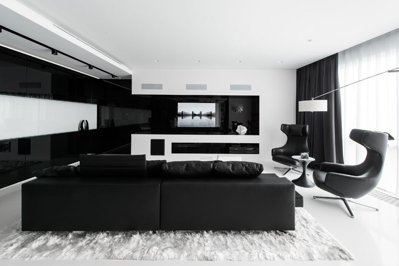 In The Living Room Of This Black And White Themed Apartment Television Is Built
