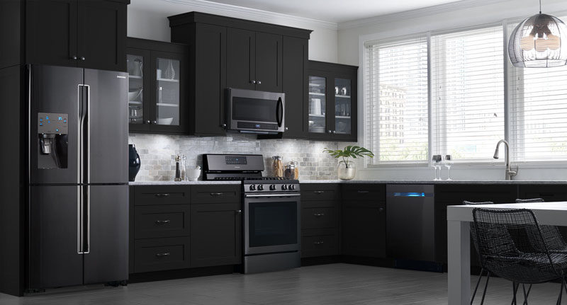 Make a statement in the kitchen with black stainless steel appliances. #BlackAppliances #BlackKitchen #BlackFridge #BlackOven #BlackDishwasher