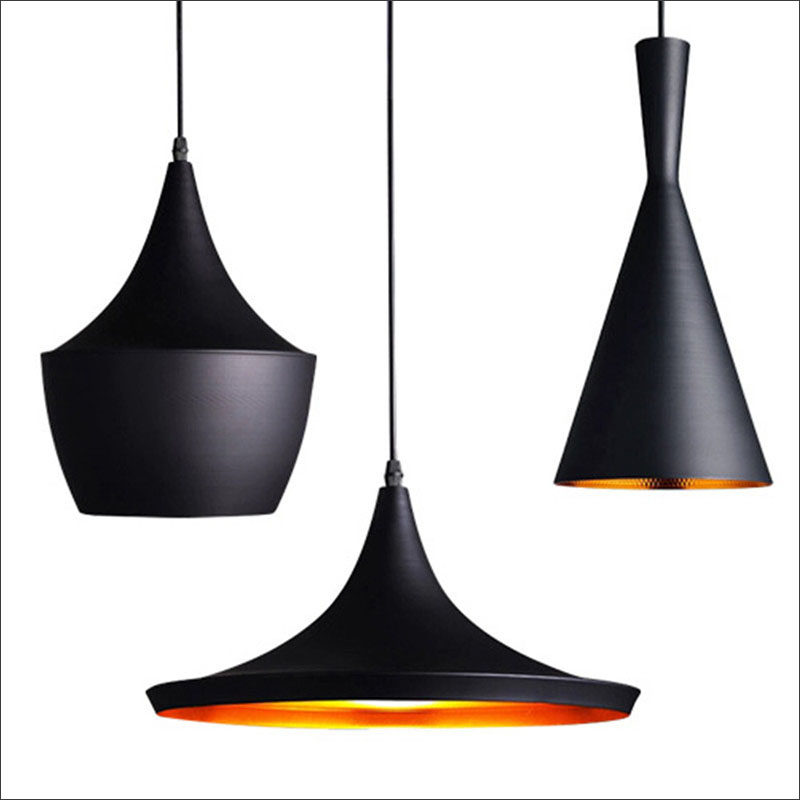 Hang black pendant lights above your kitchen island for a dramatic effect without the commitment of all black everything. #BlackLighting #BlackPendantLights