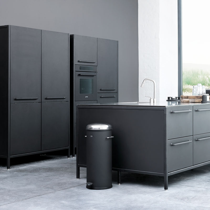 Garbage cans may not be the most exciting element of a kitchen but they're certainly necessary. A statement black one adds flair to your kitchen and creates a stylish home for your trash. #BlackGarbageBin #BlackTrashCan #BlackKitchen
