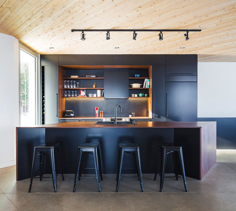 If you've got an island with space for seating, bar stools can bring in black in a stylish and functional way. #BlackBarStools #BlackSeating #BlackKitchen