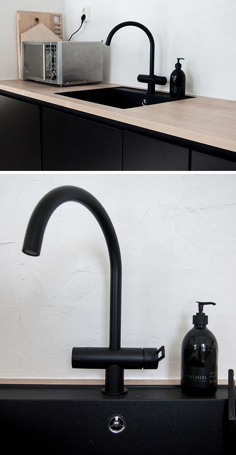 A black sink and matching faucet can tie together all the other elements of black and make for a cohesive, edgy look. #BlackKitchen #BlackSink #BlackFaucet