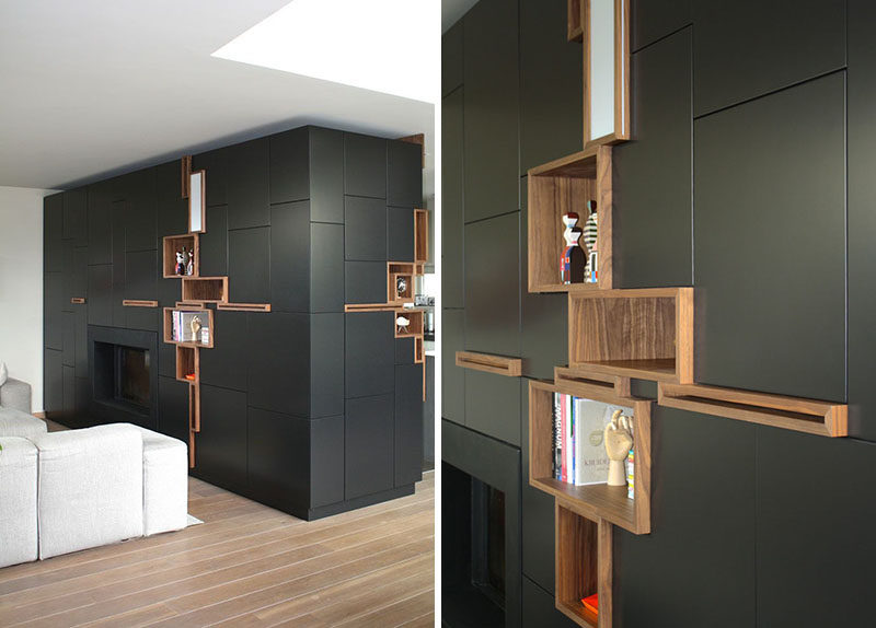 This black storage unit has some shelves surrounded in wood and left open for displaying personal items.