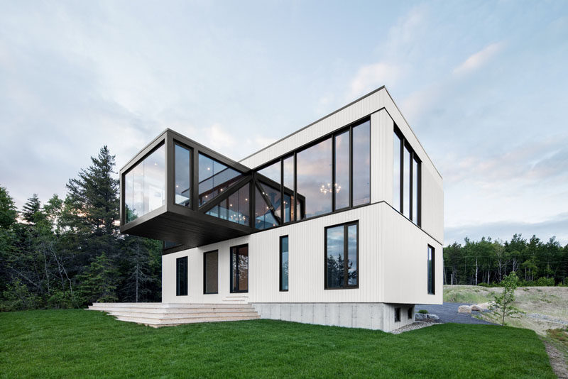 Perched overlooking the coastline of Charlevoix, Quebec, is this contemporary home that has a cantilevered living room.
