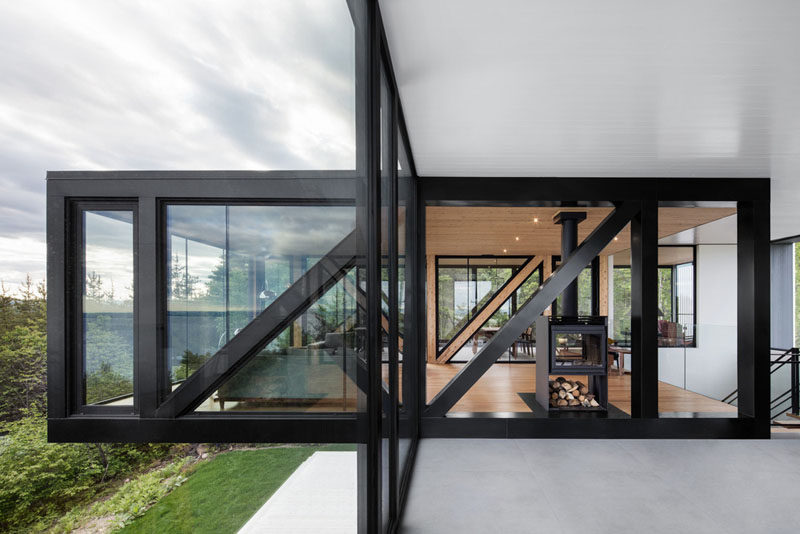 The home, designed by ACDF Architecture, has a bold black and glass box that overhangs above the garden below.