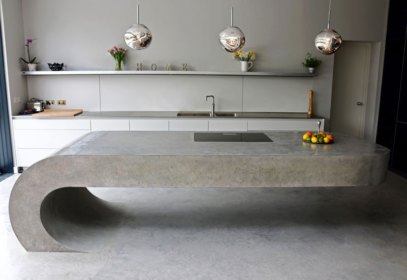 This cantilevered kitchen island is made from concrete.