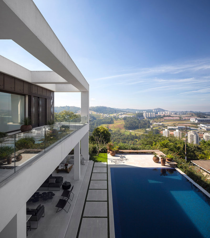 This home, with a landscaped yard and swimming pool, has sweeping views of the outskirts of Sao Paulo, Brazil.