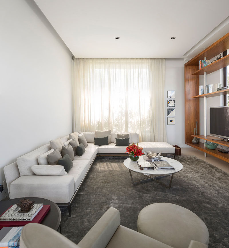 This lounge area has a built-in shelving unit to house the television and provides shelves to display your favorite items.