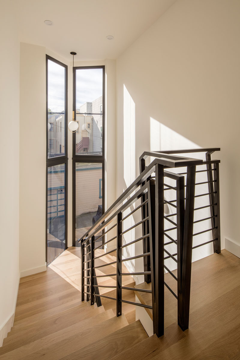 Bleached white oak flooring and black handrails give these stairs a contemporary look.