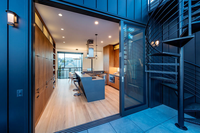 This warm wood kitchen opens up to the balcony outside.
