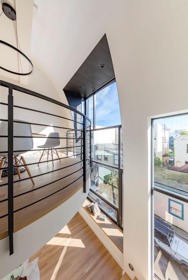 This mezzanine level has black railings to match the black window frames.