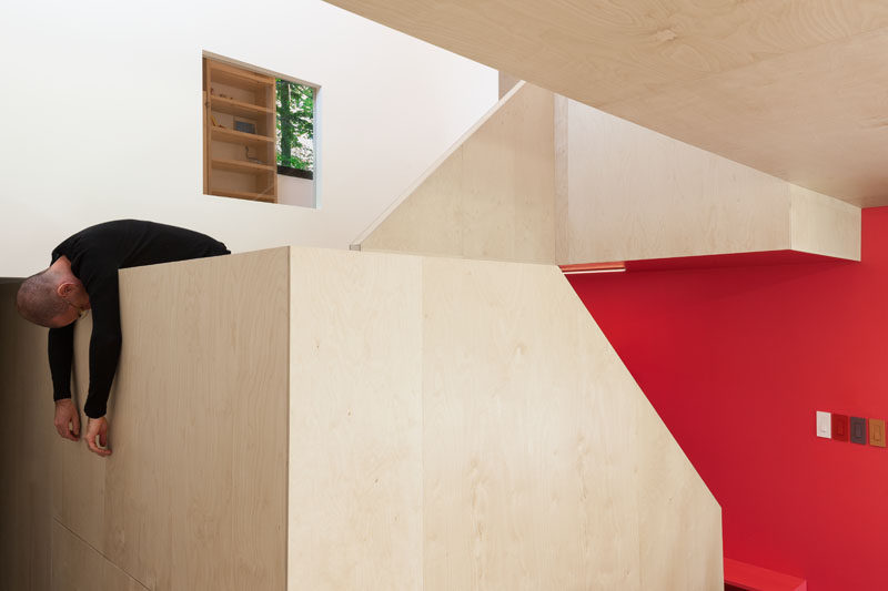 A pop of red adds a sense of playfulness to this otherwise white and wood color palette. (Don't mind the guy...that's just the architect).